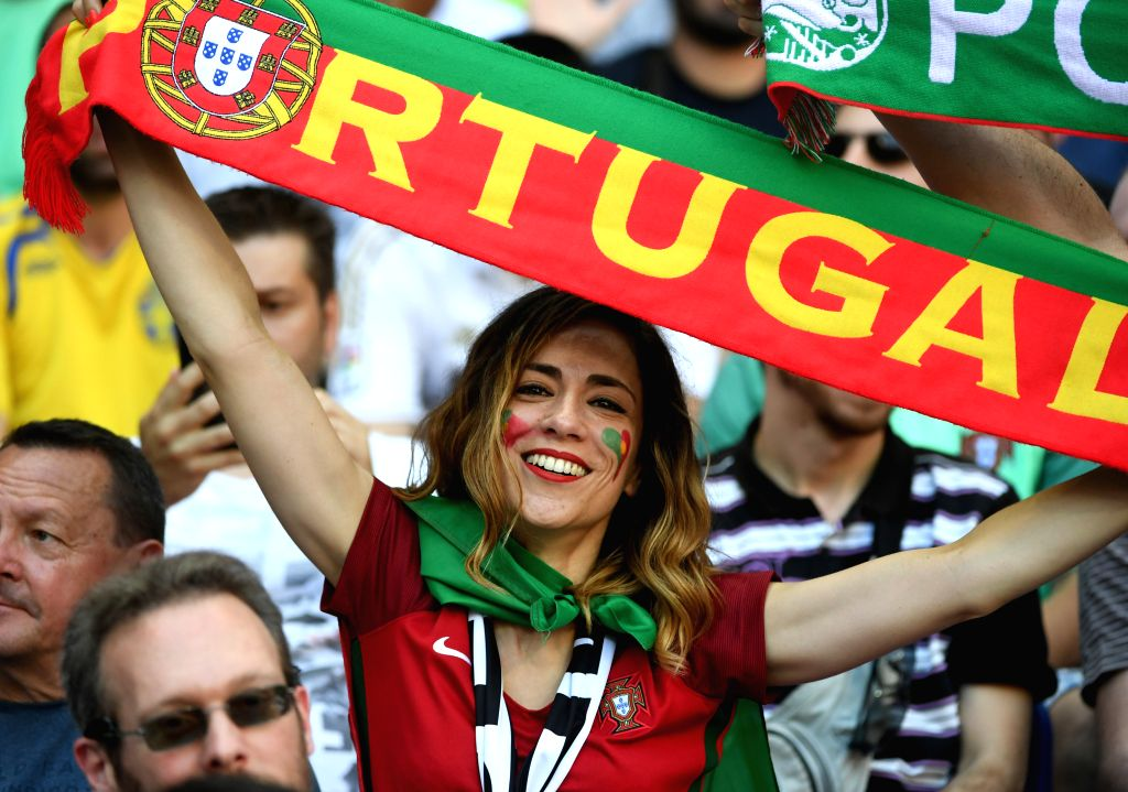 LYON, June 22, 2016 - A fan of Portugal cheers before the Euro 2016 Group F soccer match between Portugal and Hungary in Lyon, France, June 22, 2016.