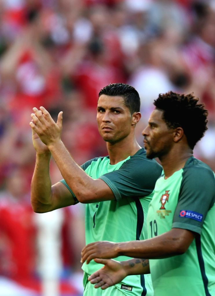 LYON, June 23, 2016 - Cristiano Ronaldo (L) of Portugal greets the spectators after the Euro 2016 Group F soccer match between Portugal and Hungary in Lyon, France, June 22, 2016. The match ended ...