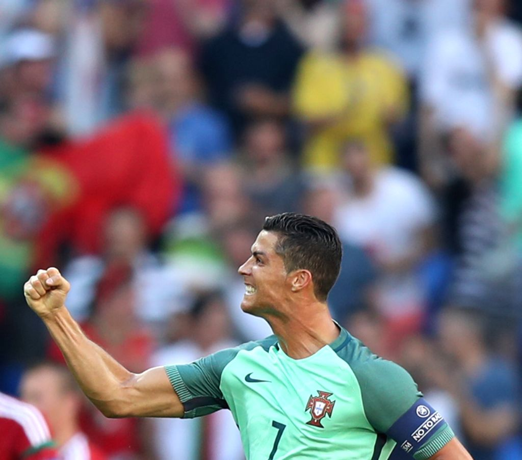 LYON, June 23, 2016 - Cristiano Ronaldo of Portugal celebrates after scoring during the Euro 2016 Group F soccer match between Portugal and Hungary in Lyon, France, June 22, 2016.