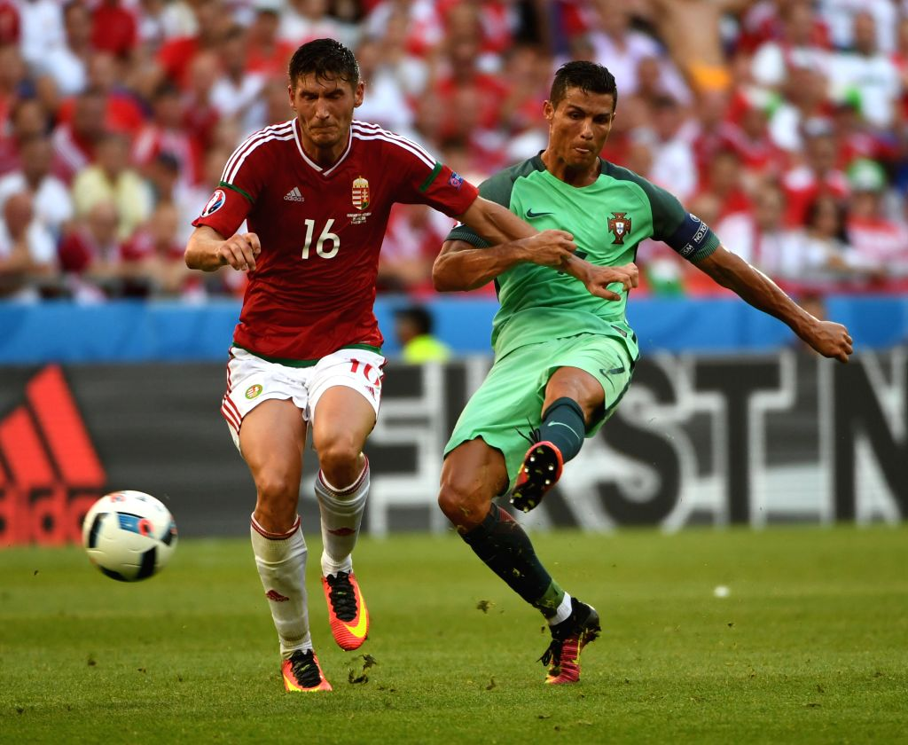 LYON, June 23, 2016 - Cristiano Ronaldo of Portugal (R) competes during the Euro 2016 Group F soccer match between Portugal and Hungary in Lyon, France, June 22, 2016. The match ended with a 3-3 draw.