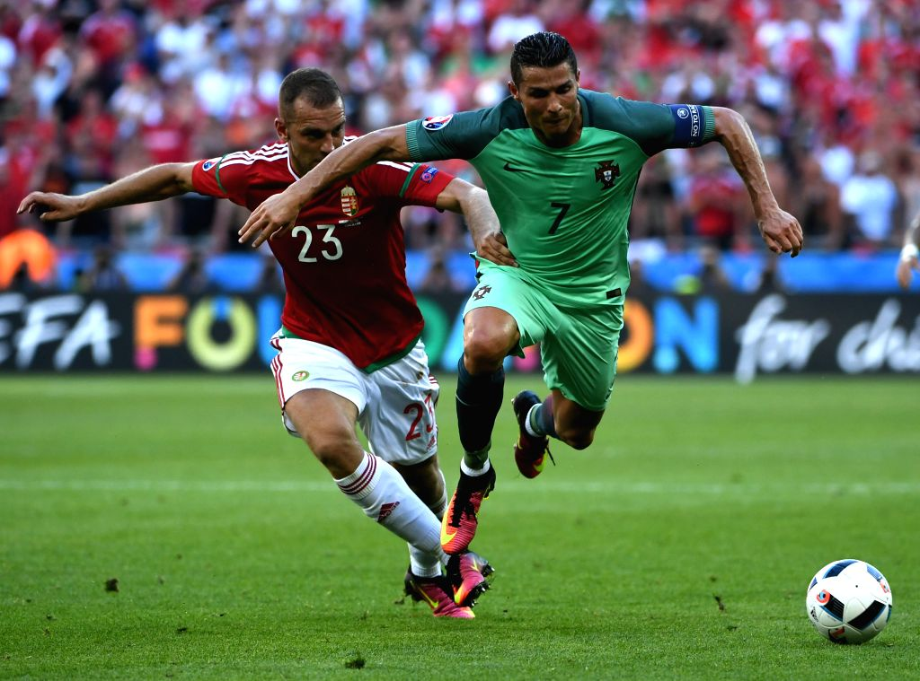 LYON, June 23, 2016 - Cristiano Ronaldo of Portugal (R) vies with Roland Juhasz of Hungary during the Euro 2016 Group F soccer match between Portugal and Hungary in Lyon, France, June 22, 2016.