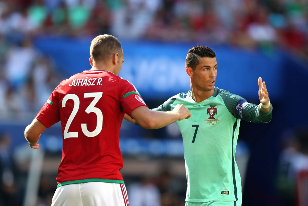 LYON, June 23, 2016 - Cristiano Ronaldo (R) of Portugal reacts during the Euro 2016 Group F soccer match between Portugal and Hungary in Lyon, France, June 22, 2016.