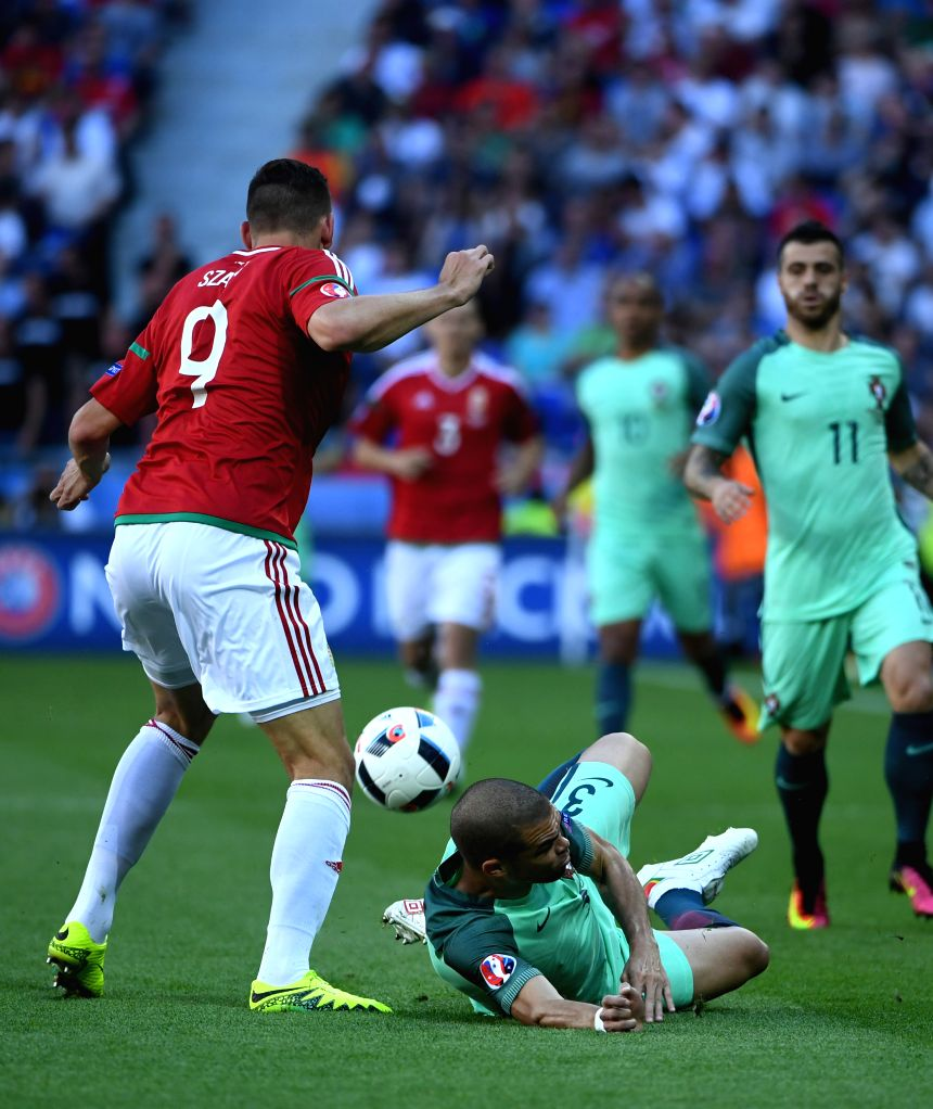 LYON, June 23, 2016 - Pepe (R) of Portugal competes during the Euro 2016 Group F soccer match between Portugal and Hungary in Lyon, France, June 22, 2016.