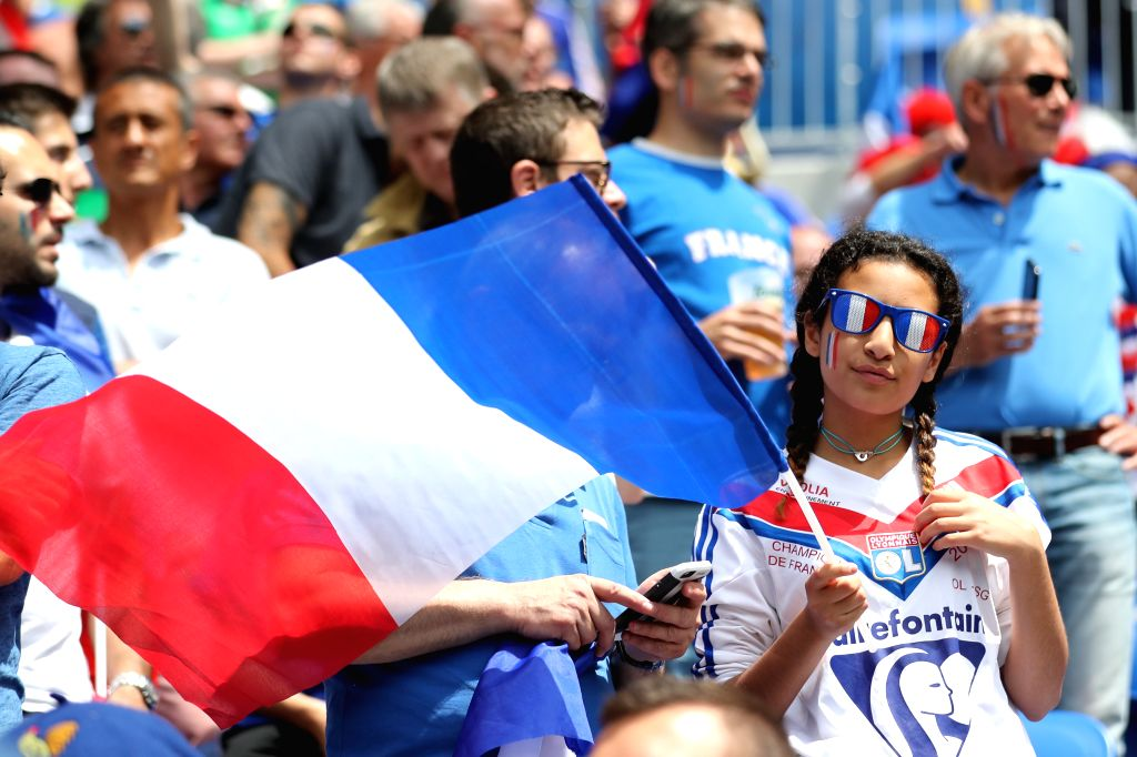LYON, June 26, 2016 - A French team supporter holds a flag prior to the Euro 2016 round of 16 football match between France and Republic of Ireland in Lyon, France, June 26, 2016.
