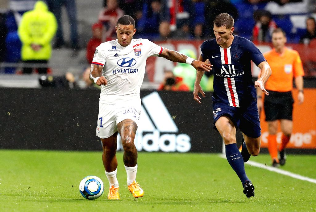 LYON, Sept. 23, 2019 - Memphis Depay (L) of Olympique Lyonnais vies with Thomas Meunier of Paris Saint-Germain during the French Ligue 1 soccer match between Olympique Lyonnais and Paris ...