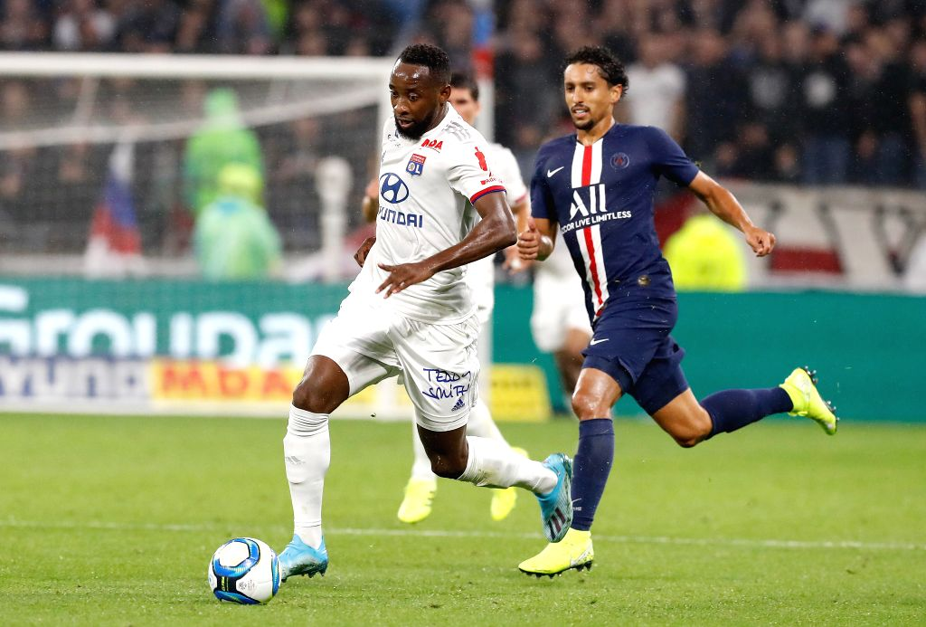 LYON, Sept. 23, 2019 - Moussa Dembele (L) of Olympique Lyonnais vies with Marquinhos of Paris Saint-Germain during the French Ligue 1 soccer match between Olympique Lyonnais and Paris Saint-Germain ...