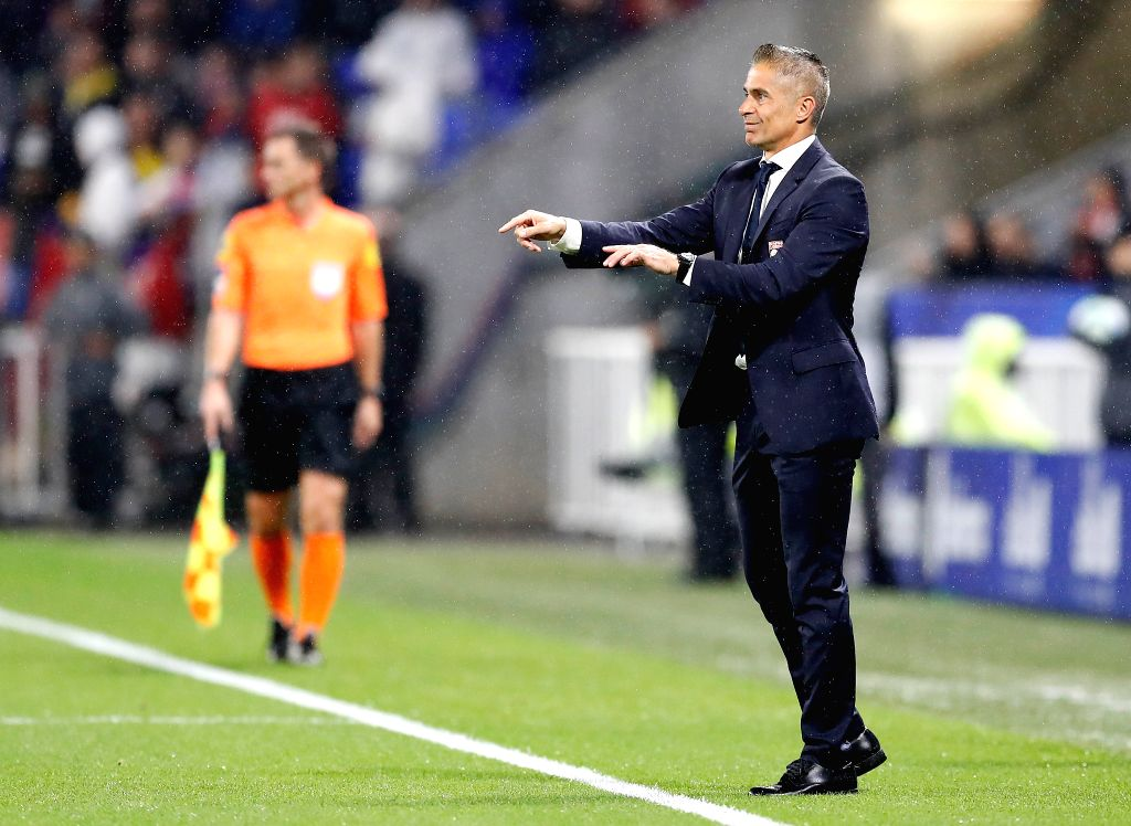 LYON, Sept. 23, 2019 (Xinhua) -- Sylvinho, head coach of Olympique Lyonnais, guestures during the French Ligue 1 soccer match between Olympique Lyonnais and Paris Saint-Germain (PSG) in Lyon, France, Sept. 22, 2019. (Photo by Francois Lemoine/Xinhua/