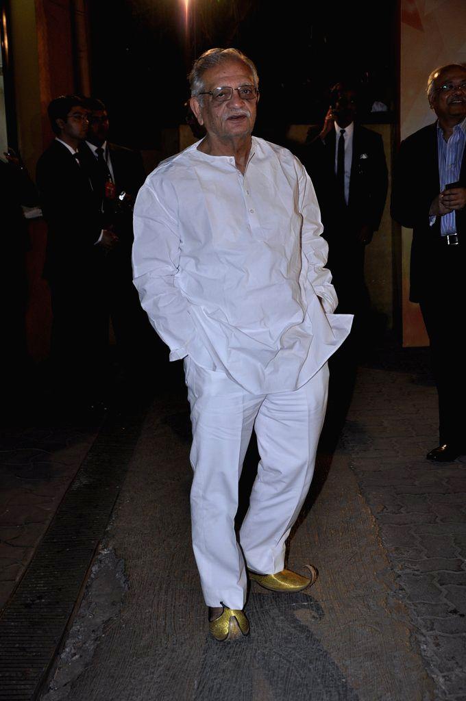 Lyricist Gulzar arrives at the red carpet of The Filmfare Awards 2013 in Mumbai.