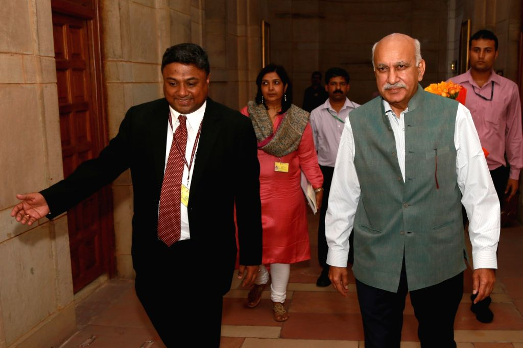 M.J. Akbar arrives to assume charge as Minister of State for External Affairs, in New Delhi on July 6, 2016.