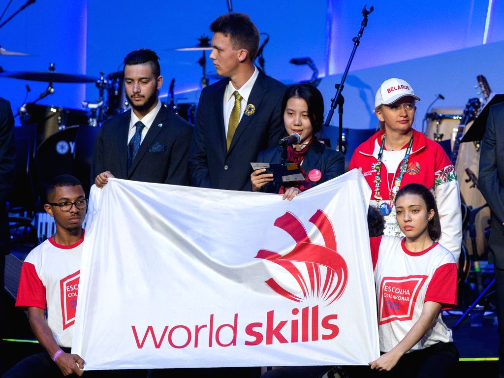 Ma Weixin (4th L), a competitor of China, takes an oath on behalf of the competitors during the opening ceremony of the 43rd Worldskills in Sao Paulo, Brazil, ...