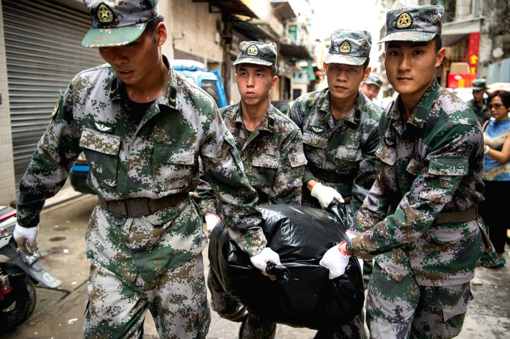 MACAO, Aug. 25, 2017 (Xinhua) -- Soldiers help with the relief work of the disaster caused by typhoon Hato in Macao Special Administrative Region (SAR), south China, Aug. 25, 2017. About 1,000 troops from the People's Liberation Army (PLA) Garrison i