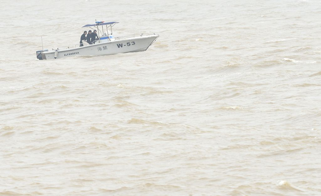 Rescuers search for the missing people on the capsized ferry on the sea in Macao, south China, Feb. 27, 2015. A ferry carrying 19 people capsized Friday off China's ...
