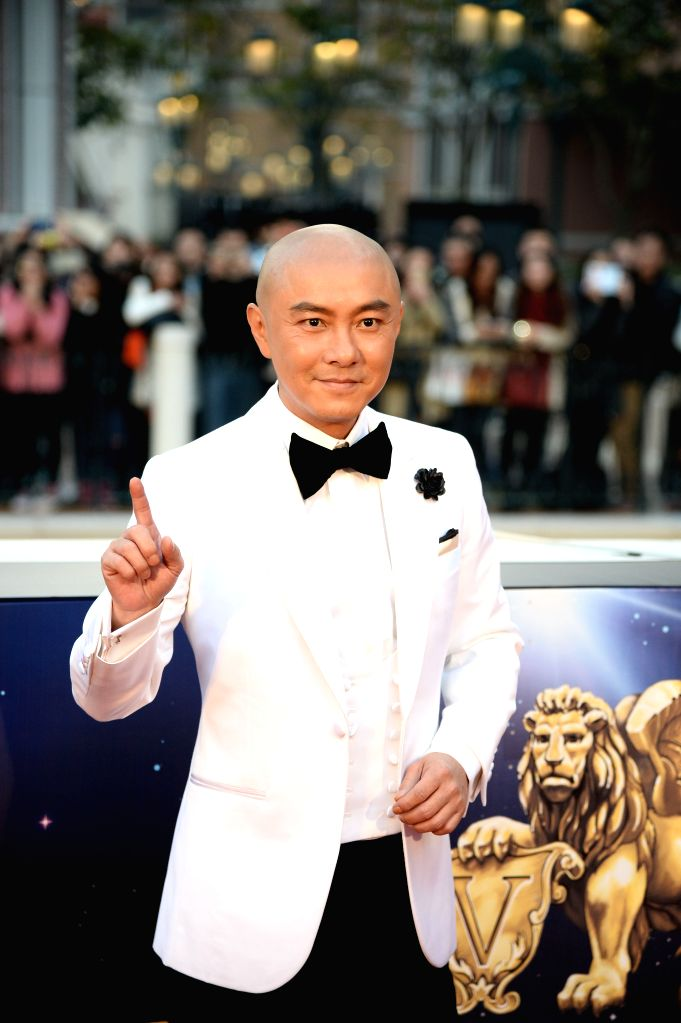 Actor Dicky Cheung arrives on the red carpet for the 15th Huading Awards, the release ceremony of the Global Entertainment Celebrities Satisfaction Survey, in Macao, . - Dicky Cheung
