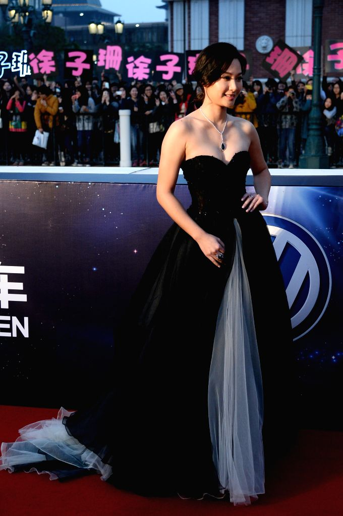 Actress Tsui Kate Tsz Shan arrives on the red carpet for the 15th Huading Awards, the release ceremony of the Global Entertainment Celebrities Satisfaction Survey, in - Tsui Kate Tsz Shan