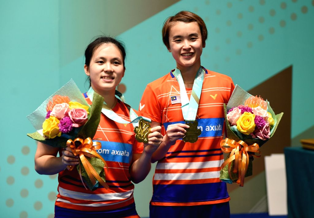 MACAO, Nov. 4, 2018 - Hoo Vivian (R)/Yap Cheng Wen of Malaysia pose during the awarding ceremony after the women's doubles final match against Aratama Misato/Watanabe Akane of Japan at the BWF Macao ...