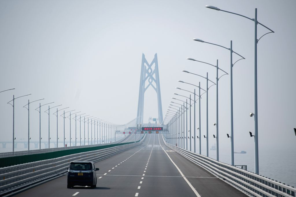 MACAO, Oct. 26, 2019 - A car heads for the Qingzhou Channel Bridge of the Hong Kong-Zhuhai-Macao Bridge in south China, Oct. 24, 2019. Launched on Oct. 23 last year, the 55-km bridge, known as the ...