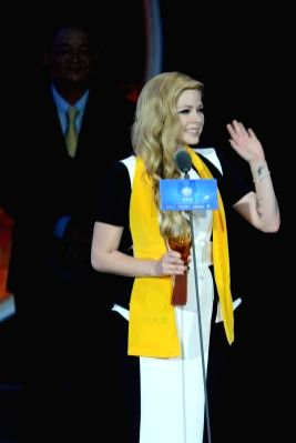 :MACAO, Oct. 8, 2013 (Xinhua/IANS)Canadian singer Avril Lavigne receives the Global Best Singer award at the awarding ceremony of the 10th Huading Awards, the release ceremony of the Global ...