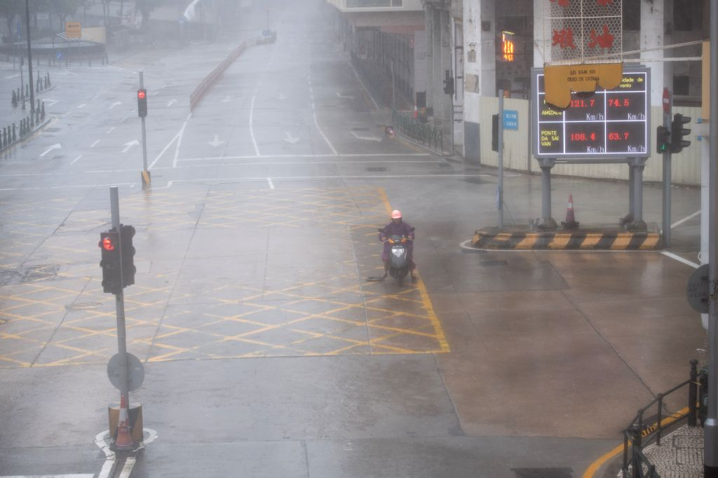 MACAO, Sept. 16, 2018 - A citizen drives a motorcycle past a street in Macao, south China, Sept. 16, 2018. Macao has upgraded its typhoon signal to highest No.10 level on Sunday at 11:00 a.m. local ...