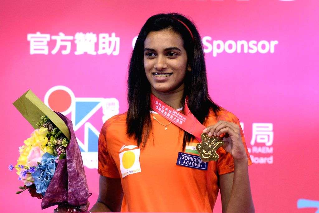 Indian badminton player P V Sindhu shows her medal during post match presentation ceremony after winning the 2014 Macau Grand Prix Gold in Macau, China on Nov 30, 2014. Sindhu defeated South ..