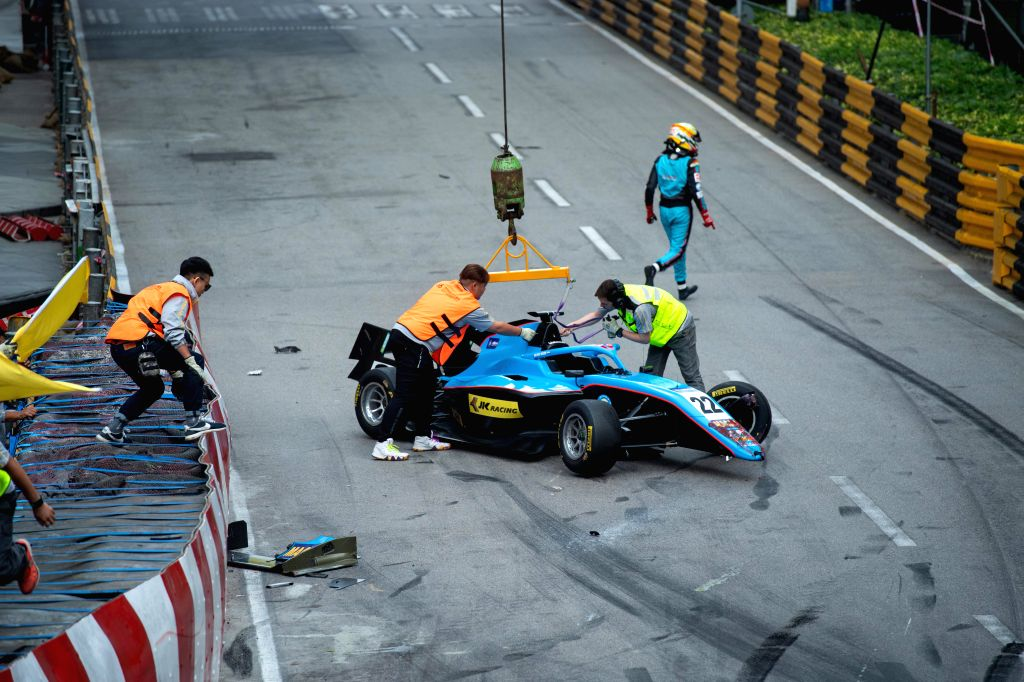 MACAU, Nov. 16, 2019 - Indian driver Arjun Maini (1st R) leaves the circuit after he crashed his car in a curve during the qualification race of Formula 3 Macau Grand Prix and FIA F3 World Cup at the ...