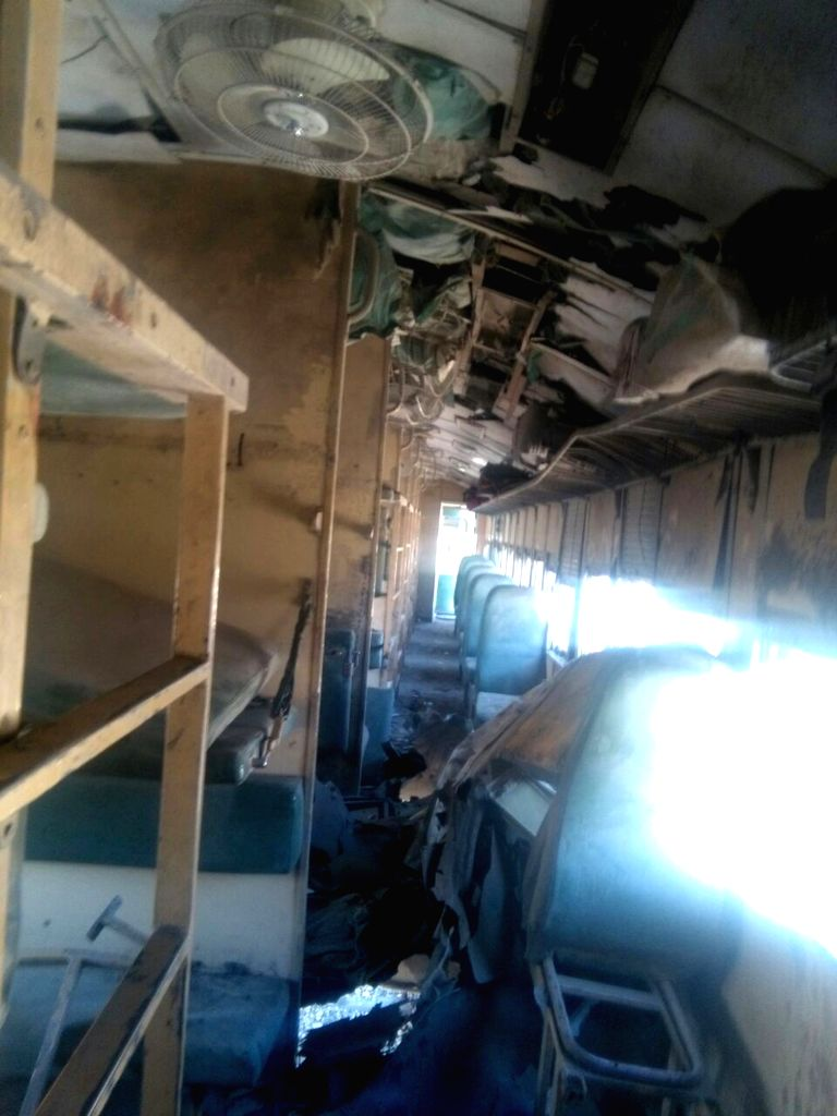 MACH, Oct. 7, 2016 - A damaged compartment of a passenger train is seen following twin blasts on a railway track in Mach district, Pakistan's southwest Balochistan Province, Oct. 7, 2016. At least ...