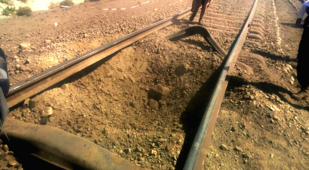 MACH, Oct. 7, 2016 - Pakistani officials examine damaged railway track following twin blasts on a railway track in Mach district, Pakistan's southwest Balochistan Province, Oct. 7, 2016. At least ...