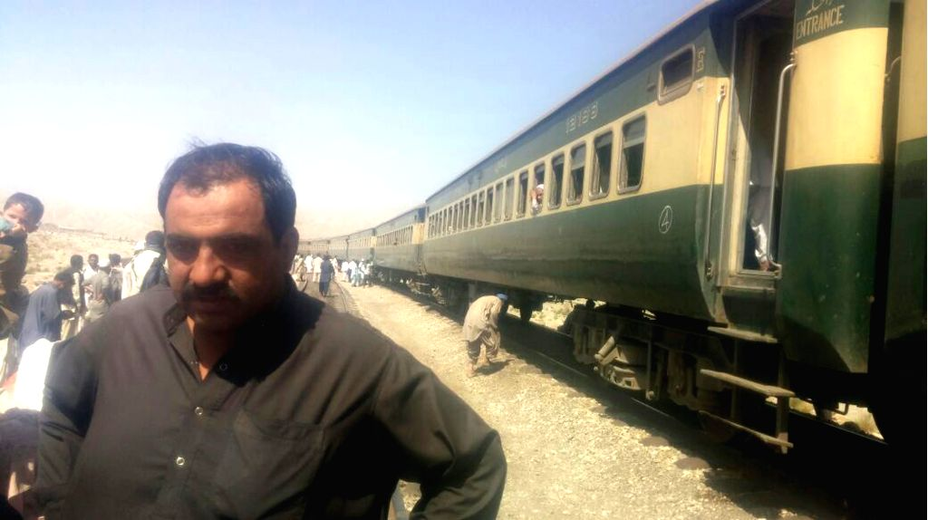 MACH, Oct. 7, 2016 - Pakistani officials examine the passenger train following twin blasts on a railway track in southwest Pakistan's Mach, Oct. 7, 2016. At least four people were killed and 16 ...