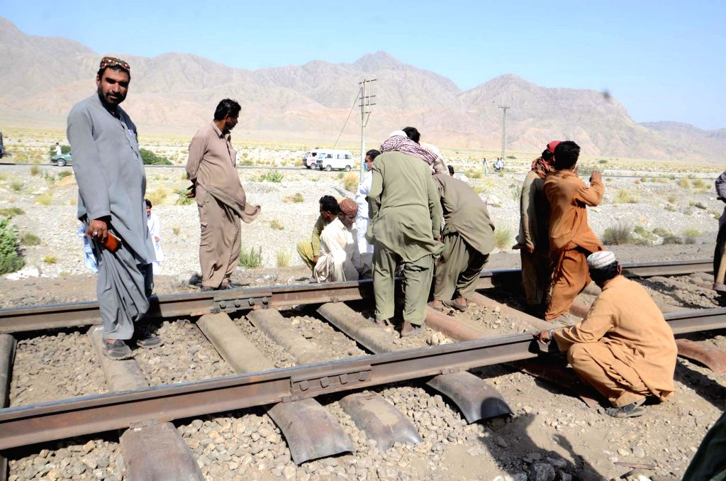 MACH, Oct. 7, 2016 - Pakistani workers repair damaged railway track at the twin blasts site in southwest Pakistan's Mach on Oct. 7, 2016. At least eight people were killed and 19 others injured when ...