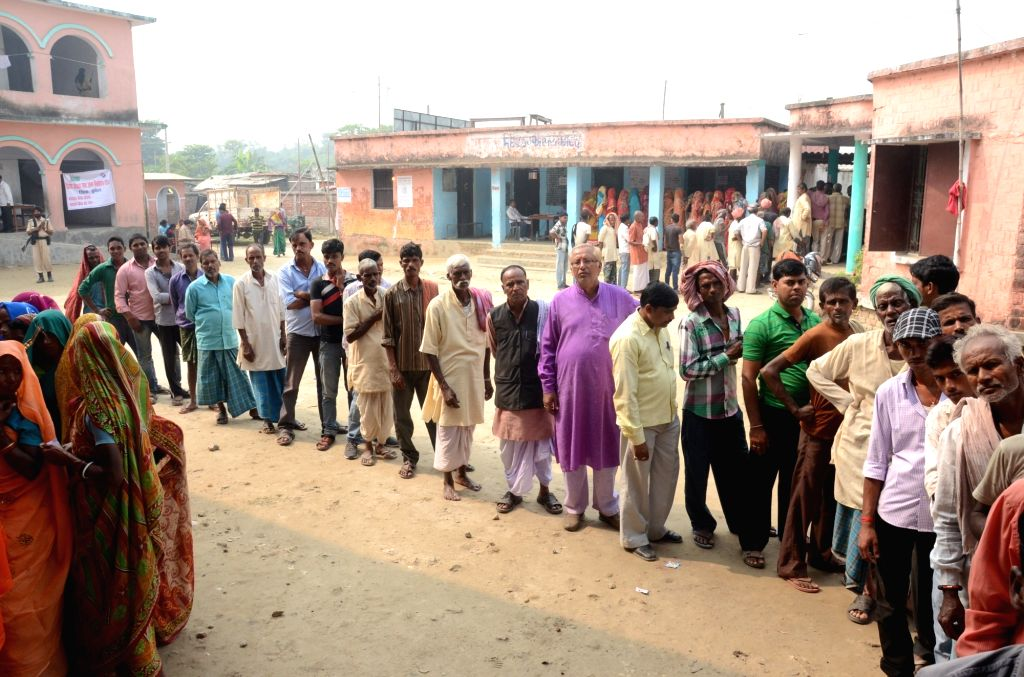 :Madhepura: People queue-up to cast their votes at a polling booth during the final phase of Bihar assembly polls in Madhepura district of Bihar on Nov. 5, 2015. (Photo: IANS).