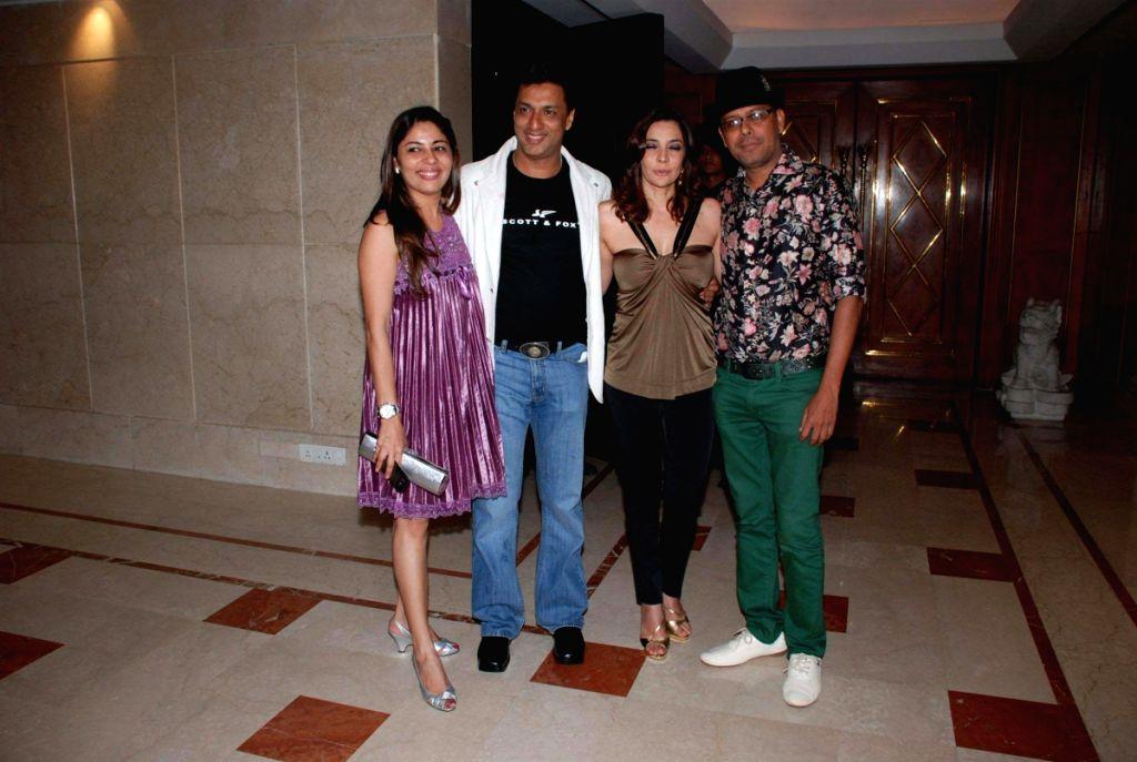 Madhur Bhandarkar with wife, Rita Dhody and Narendra Kumar at Kangana's birthday bash. - Narendra Kumar