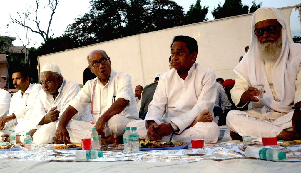Madhya Pradesh Chief Minister Kamal Nath and Congress leader Digvijay Singh during an Iftar party in Bhopal, on June 2, 2019. - Kamal Nath and Digvijay Singh