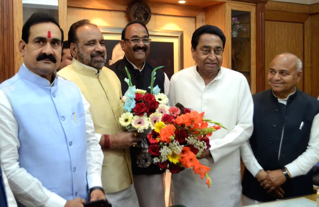 Madhya Pradesh Chief Minister Kamal Nath and er of Opposition Gopal Bhargav greet state assembly speaker N.P. Prajapati at the assembly ahead of Budget Session of the assembly in Bhopal ... - Kamal Nath