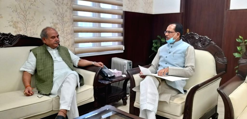Madhya Pradesh Chief Minister Shivraj Singh Chouhan calls on Union Agriculture and Farmers' Welfare Minister Narendra Singh Tomar, in New Delhi on July 6, 2020. Chouhan also submitted a ... - Shivraj Singh Chouhan and Narendra Singh Tomar