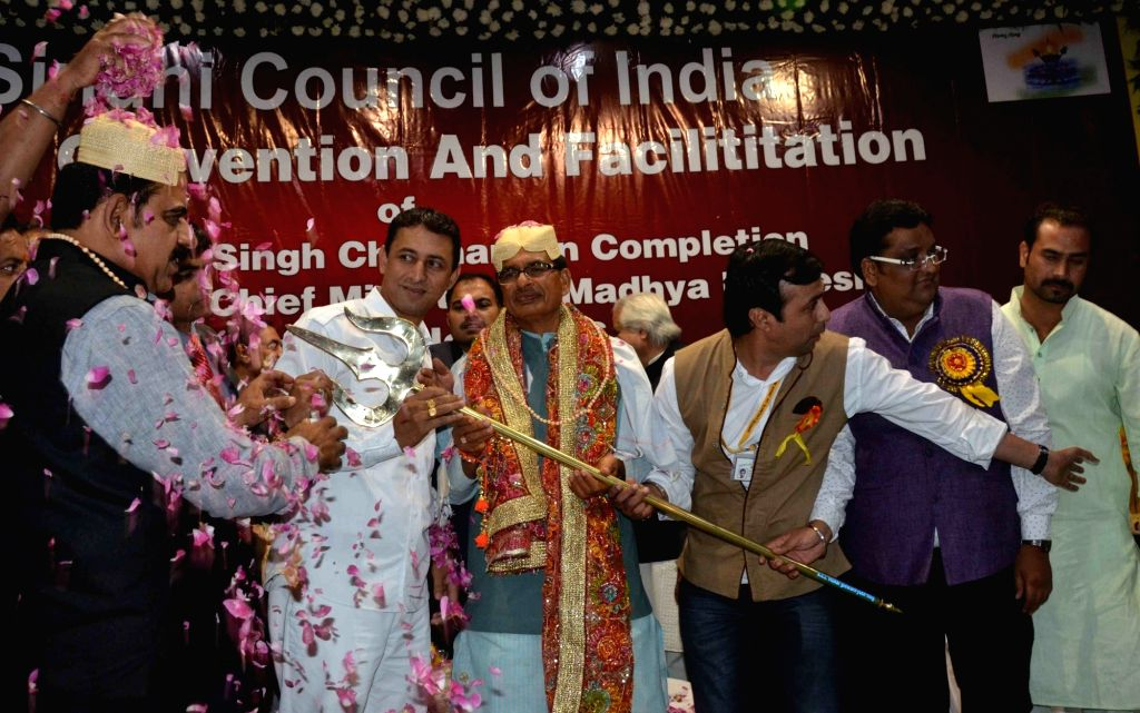 Madhya Pradesh Chief Minister Shivraj Singh Chouhan being presented a trident by members of Sindhi community during a programme in Bhopal on Nov 27, 2016. - Shivraj Singh Chouhan