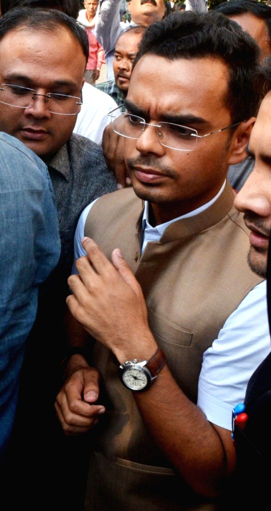 Madhya Pradesh Chief Minister Shivraj Singh Chouhan's son Kartikey Chouhan comes out of a court after recording his statement in the defamation case filed by him against Rahul Gandhi; in ... - Shivraj Singh Chouha and Rahul Gandhi