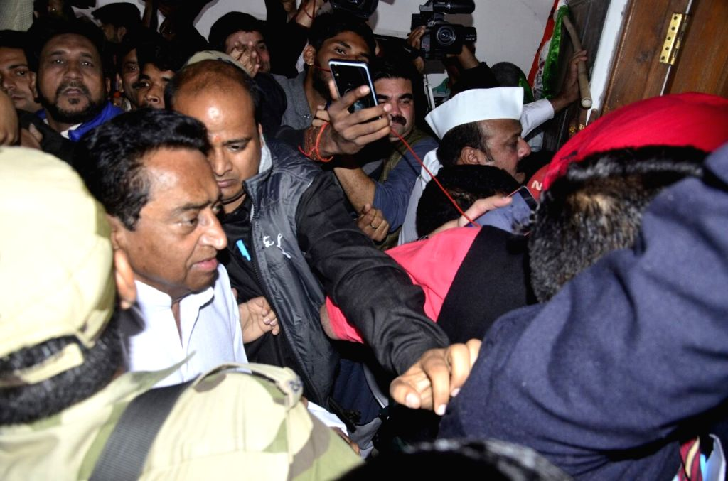 Madhya Pradesh Congress President Kamal Nath being greeted by party workers as he arrives at party office in Bhopal on Dec 11, 2018. He wrote a letter to Governor Anandiben Patel late on ... - Kamal Nath and Anandiben Patel