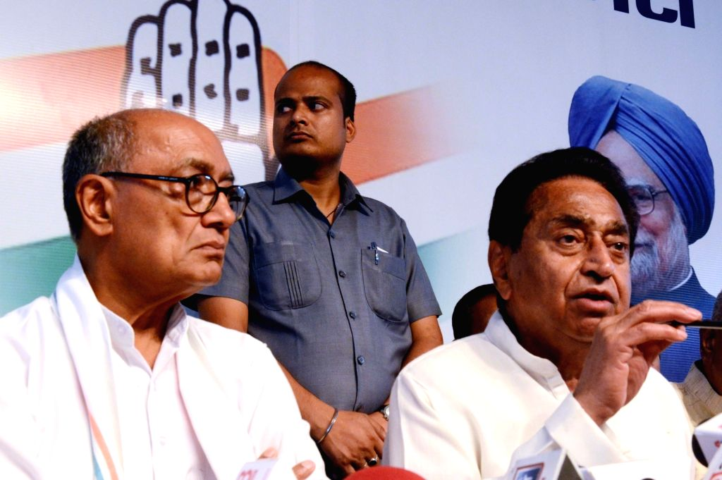 Madhya Pradesh Congress President Kamal Nath and Chairman of coordination committee for the state Digvijay Singh during a press conference, in Bhopal on May 24, 2018. - Kamal Nath and Digvijay Singh