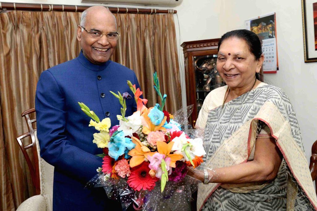 Madhya Pradesh Governor designate Anandiben Patel calls on President Ram Nath Kovind at Raj Bhavan in Gandhinagar on Jan 21, 2018. - Anandiben Patel and Nath Kovind