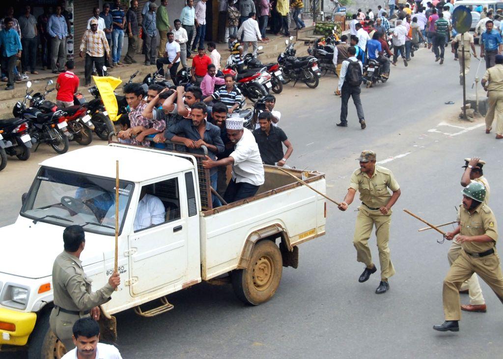 :Madikeri: People charge lathis on people staging a demonstration against Tipu Sultan Jayanti celebrations in Madikeri, Kodagu District of Karnataka on Nov 10, 2015. (Photo: IANS).