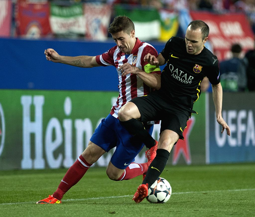 Atletico Madrid's Gabi (L) vies with Barcelona's Andres Iniesta (R) during their UEFA Champions League quarter-final match at Vicente Calderon stadium in Madrid, ...