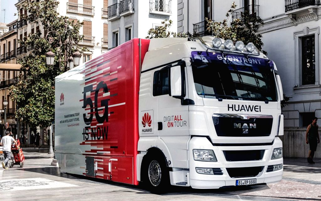 "MADRID, April 24, 2018 (Xinhua) -- Photo taken on April 23, 2018 shows the Huawei 5G Truck at its roadshow in Madrid, Spain. ""Spain is our top 5G priority market,"" said Huawei Spain CEO Tony Jin Yong at the presentation of the telecommunications gian"