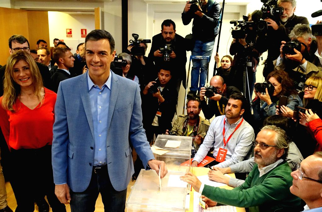 MADRID, April 28, 2019 - Spanish Prime Minister Pedro Sanchez (2nd L, front) casts his ballot at a polling station in Madrid, Spain, April 28, 2019. Spain's polling stations opened on Sunday at 09:00 ... - Pedro Sanchez