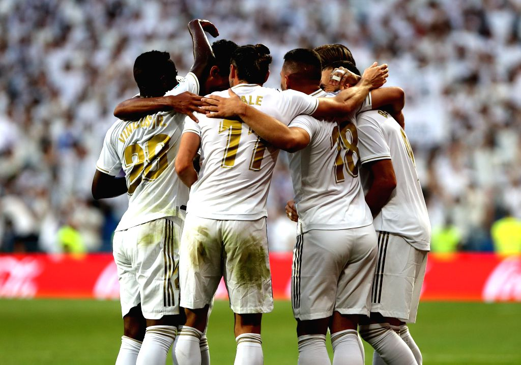 MADRID, Aug. 25, 2019 - Players of Real Madrid celebrate during a Spanish league soccer match between Real Madrid and Valladolid in Madrid, Spain, on Aug. 24, 2019.
