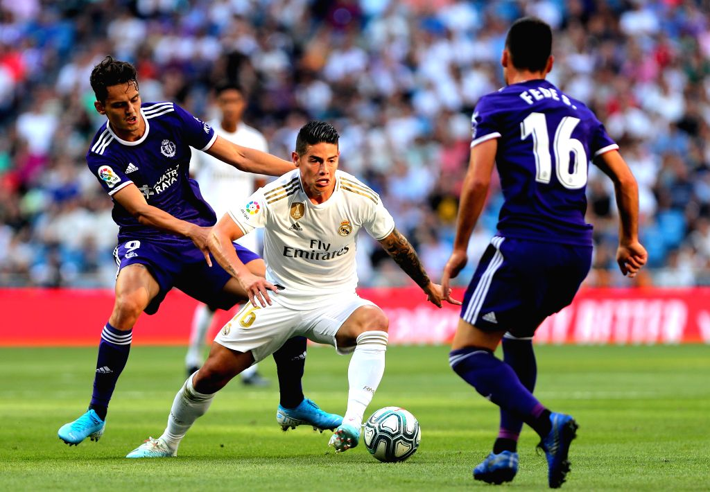 MADRID, Aug. 25, 2019 - Real Madrid's James Rodriguez (C) competes with Valladolid's Enes Unal (L) during a Spanish league soccer match between Real Madrid and Valladolid in Madrid, Spain, on Aug. ...