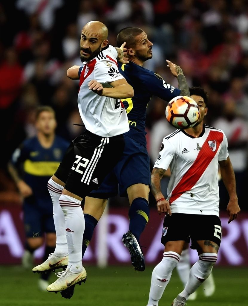 MADRID, Dec. 10, 2018 - Boca Juniors' Dario Benedetto (top R) vies for a header with River Plate's Javier Pinola (top L) the second round of Copa Libertadores final between River Plate and Boca ...
