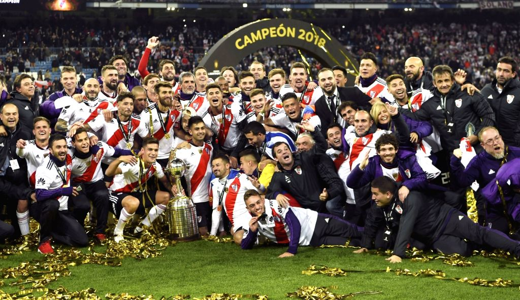 MADRID, Dec. 10, 2018 - Players and staff of River Plate celebrate their victory after the second round of Copa Libertadores final between River Plate and Boca Juniors in Madrid, Spain, on Dec. 9, ...