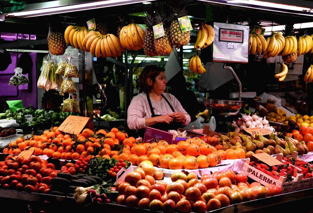 MADRID, Feb. 1, 2019 - A booth owner works in Ruzafa Market in Valencia, Spain, Jan. 31, 2019.