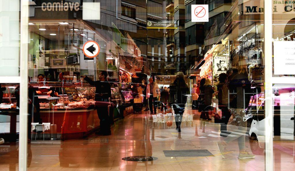 MADRID, Feb. 1, 2019 - People are seen through the door of Ruzafa Market in Valencia, Spain, Jan. 31, 2019.