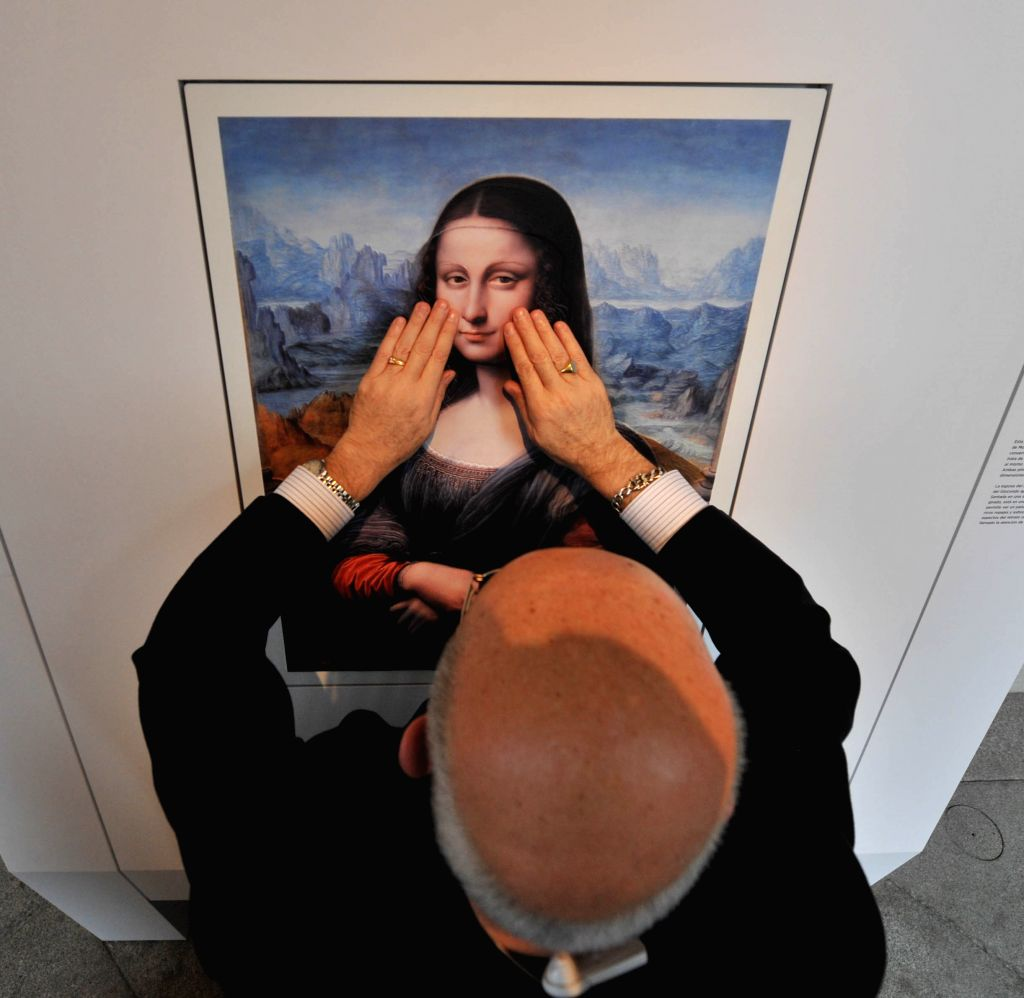 A blind visitor touches an exhibit at Prado Museum in Madrid, Spain, on Feb. 10, 2015. The Prado museum opened a exposition for the blind by making copies of six ...