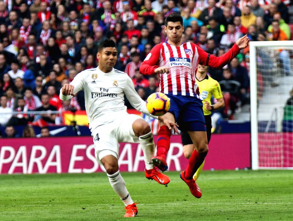 MADRID, Feb. 10, 2019 - Atletico Madrid's Alvaro Morata (R) competes with Real Madrid's Casemiro during a Spanish league match between Atletico Madrid and Real Madrid in Madrid, Spain, on Feb. 9, ...